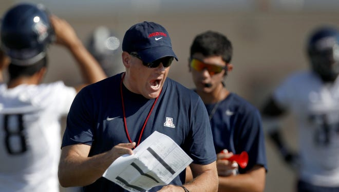 The Pac-12 will codify into a formal policy the existing practices across the Conference as they relate to limiting contact in football practice. (Arizona coach Rich Rodriguez is shown at a practice last season).