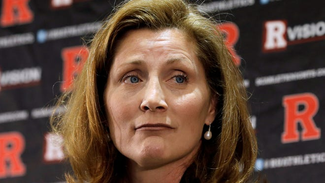 Julie Hermann at a news conference where she was introduced as the new athletic director at Rutgers University. Hermann, hired to clean up Rutgers' scandal-scarred athletic program, quit as Tennessee's women's volleyball coach 16 years ago after her players submitted a letter complaining she ruled through humiliation, fear and emotional abuse.