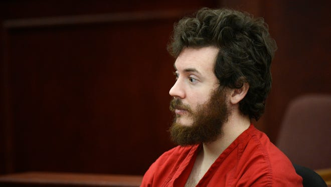 James Holmes, Aurora theater shooting suspect, sits in the courtroom during his arraignment in Centennial, Colo., last March.