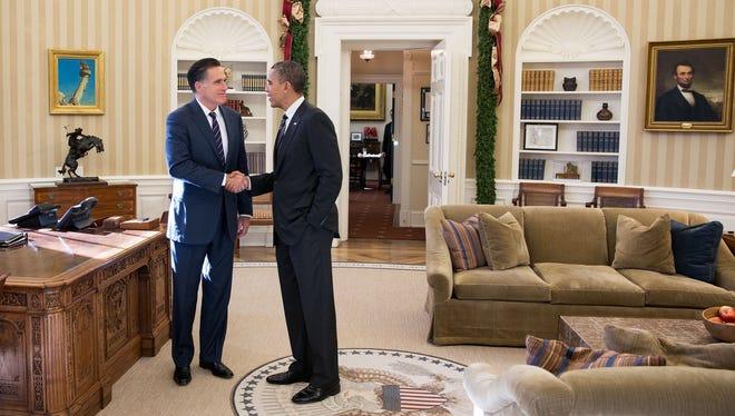 President Obama and Mitt Romney talk in the Oval Office  on Nov. 29, 2012, in Washington.