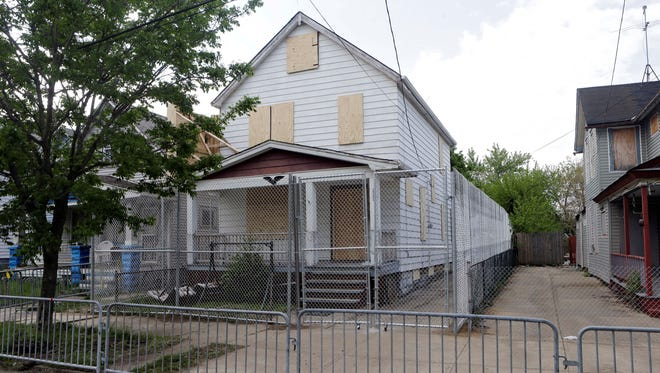 A 10-foot chain link fence surrounds the home of Ariel Castro in Cleveland.
