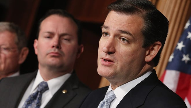 Sen. Mike Lee, R-Utah, left, and Sen. Ted Cruz, R-Texas, joined two other GOP colleagues to write a letter Tuesday explaining their opposition to a sweeping immigration bill.