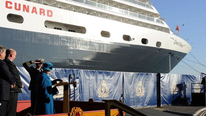 Seventy-two years after her mother christened Cunard's original Queen Elizabeth, Britain's Queen Elizabeth II presses a button to release a bottle against the bow of the latest ship to carry the name. The ceremony took place on Oct. 11, 2010 in Southampton, England.