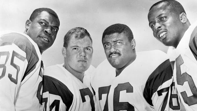 "This 1964 handout provided by NFL photos,  shows the Los Angeles Rams defensive front four, known as the ""Fearsome Foursome."" from left to right are Lamar Lundy (85), Merlin Olsen (74), Rosey Grier (76), and Deacon Jones (75). David ""Deacon"" Jones, a Hall of Fame defensive end credited with terming the word sack for how he knocked down quarterbacks, has died. He was 74.  The Washington Redskins said that Jones died Monday night June 3, 2013 of natural causes at his home in Southern California."