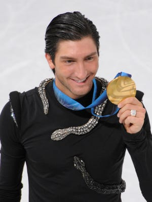 Evan Lysacek celebrates after the free skate  at the 2010 Vancouver Olympics.