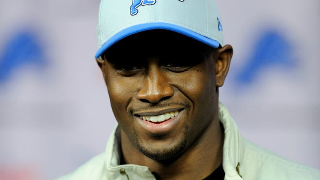 Reggie Bush, shown speaking at a news conference after agreeing to a four-year deal with the Detroit Lions in March, says teh team has the players to win a Super Bowl.