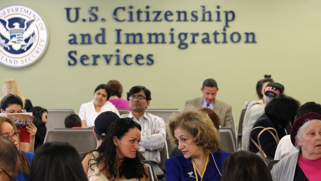 Immigrants await their turn for green card and citizenship interviews at the U.S. Citizenship and Immigration Services office in New York City on May 30.