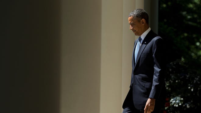 President Obama arrives to make a statement in the Rose Garden on Tuesday in which he announced three court appointments.