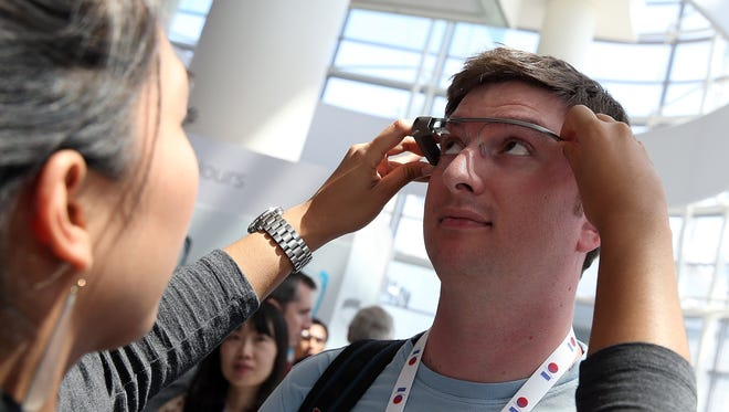 An attendee is fitted with Google Glass during the Google I/O developer conference on May 17 in San Francisco.