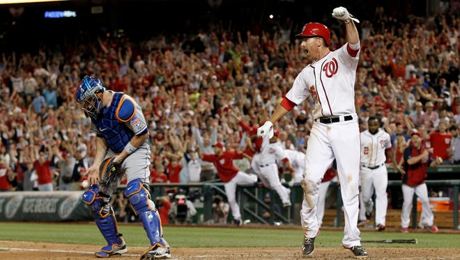 Nationals' Adam LaRoche celebrates scoring the winning run on Steve Lombardozzi's walk-off sacrifice fly in the ninth inning against the Mets.
