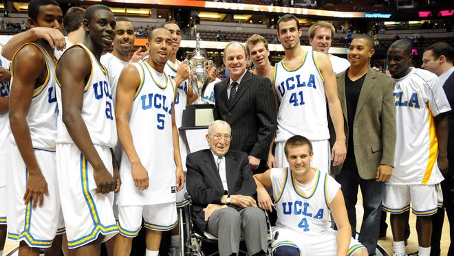 John Wooden poses with the UCLA Bruins and coach Ben Howland after 72-54 victory over the De Paul Blue Demons in the 2008 Wooden Classic at the Honda Center.