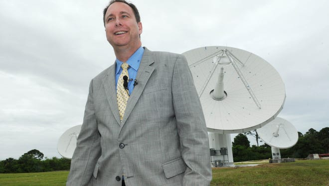 NASA Associate Administrator Robert Lightfoot stands in front of a trio of radio antennas, part of the Ka-Band Objects Observation and Monitoring (KaBOOM) system at KSC.  The system is a test bed for using Ka-Band radar and  other technologies to map near-Earth objects.