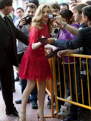 British actress Natalie Dormer poses with fans in Madrid on Tuesday.