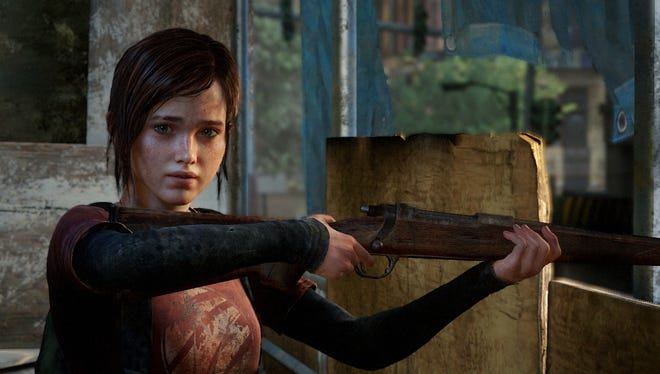 Ellie, a 14-year-old girl escorted by Joel, appears in a scene from 'The Last of Us.'
