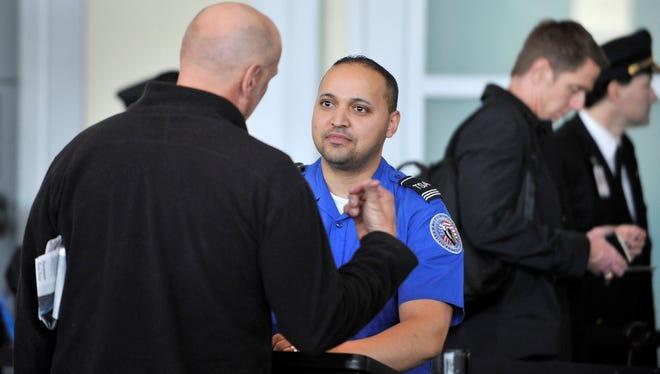 A TSA agent interviews a traveler as part of Boston Logan Airport's enhanced behavior detection program on Oct. 7, 2011.