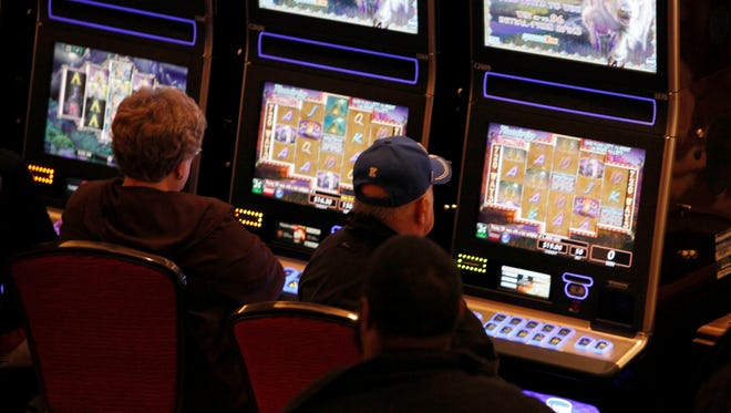 The bright lights of video poker enthrall players on the opening night of Horseshoe Casino Cincinnati.