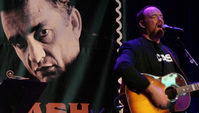 John Carter Cash performs at a first-day-of-issue ceremony for a postage stamp honoring his father, the late Johnny Cash.
