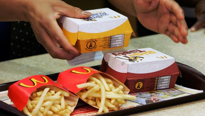 McDonald's will serve limited breakfast items after midnight at some locations.