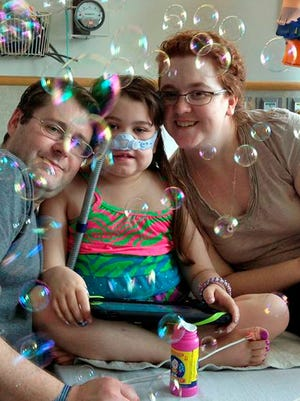 On May 30, Sarah Murnaghan celebrated her 100th day in Children's Hospital of Philadelphia with her father, Fran, and mother, Janet.
