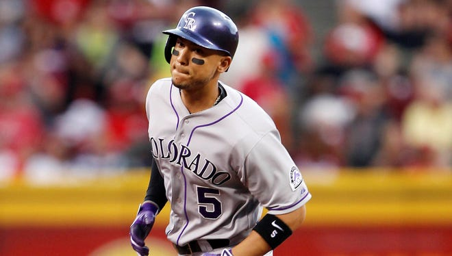 Colorado Rockies left fielder Carlos Gonzalez rounds second base after hitting a home run during the first inning against the Cincinnati Reds at Great American Ball Park.