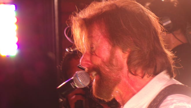 Ronnie Dunn sings on the rooftop of Rippy's Bar and Grill in Nashville on Wednesday.