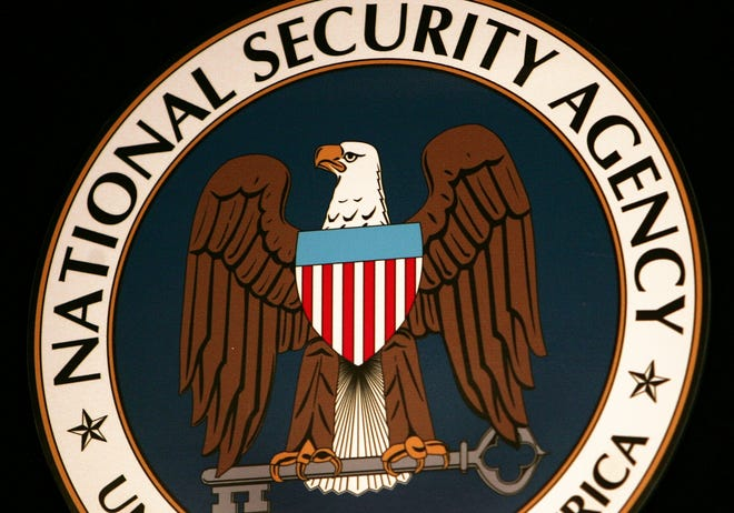 The logo of the National Security Agency (NSA) hangs at the Threat Operations Center inside the NSA in the Washington suburb of Fort Meade, Md.