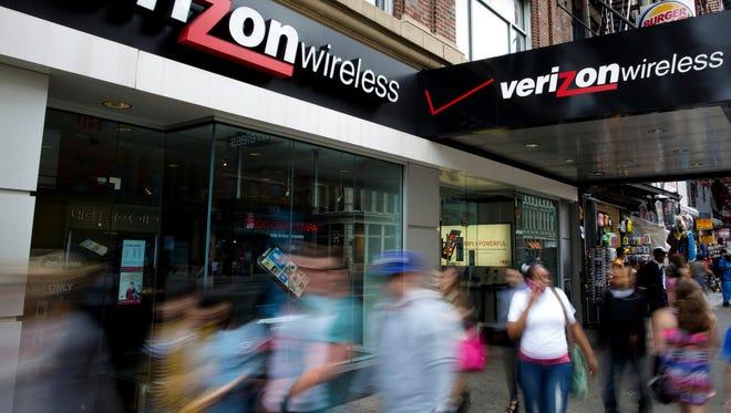 Pedestrians pass a Verizon Wireless store on Canal Street in New York.