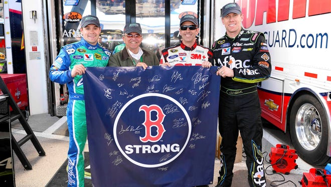 The Roush Fenway Racing team (left to right) Ricky Stenhouse Jr., owner Jack Roush, Greg Biffle and Carl Edwards show their support for victims of the Boston Marathon explosion on April 19.