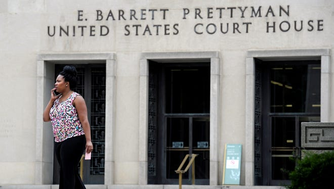 A woman on the phone outside the Foreign Intelligence Surveillance Court on Thursday.
