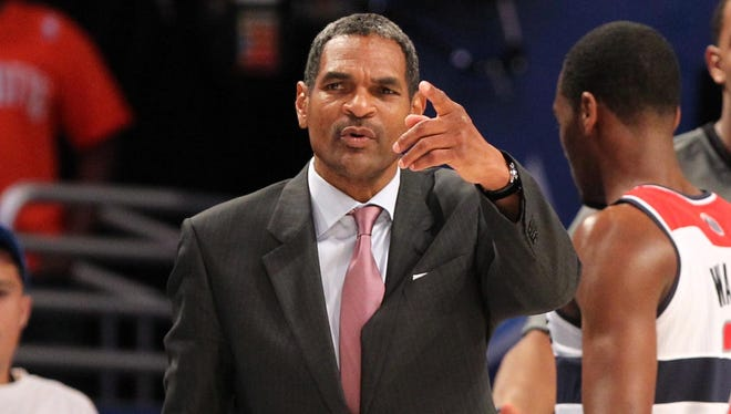 Maurice Cheeks talks to an official while coaching Team Chuck in the 2012 BBVA rising stars challenge at the Amway Center in Orlando.