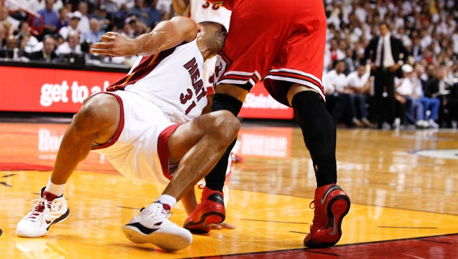 Heat forward Shane Battier takes a hit from Bulls forward Carlos Boozer during the second round of the playoffs.