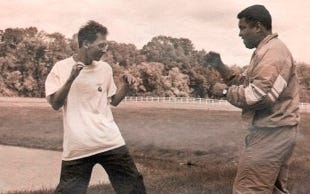 Davis Miller, left, and Muhammad Ali spar in the late 1980s in Ali's mother's yard.