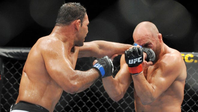 Antonio Nogueira, left, defeated  Randy Couture during their heavyweight bout at UFC 102 in 2009. Nogueira defeated Couture.