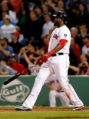 David Ortiz watches his game-winning homer leave the yard.