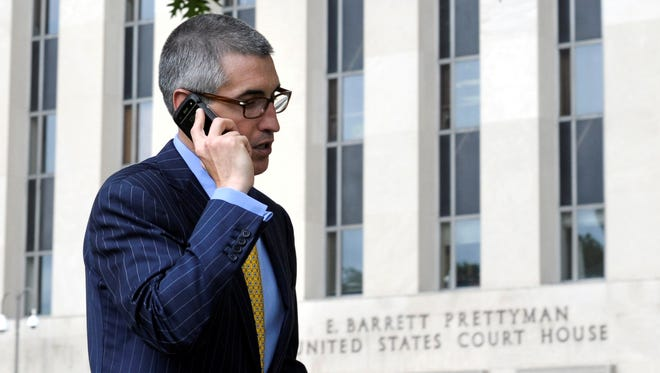 A man talks on the phone outside the U.S. Courthouse in Washington, where the secret Foreign Intelligence Surveillance Court resides.