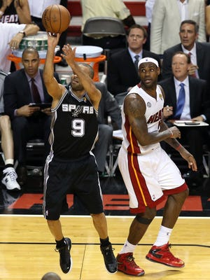 Spurs guard Tony Parker makes a key buzzer-beating jumper in front of Heat forward LeBron James in Game 1 of the NBA Finals.