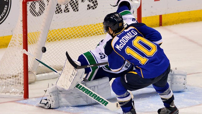 St. Louis Blues center Andy McDonald  scores a shootout goal against Vancouver Canucks goalie Cory Schneider in April.