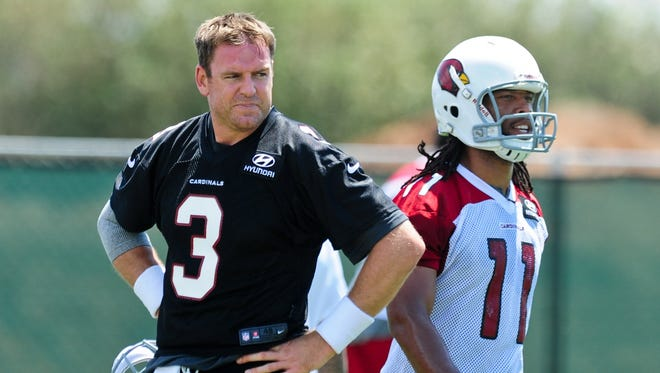 Carson Palmer (3) and Larry Fitzgerald (11) have had high praise for one another thus far in offseason workouts.