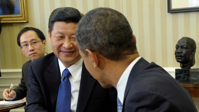 President Obama meets with then Chinese Vice President Xi Jinping on Feb., 14, 2012, in the Oval Office of the White House.