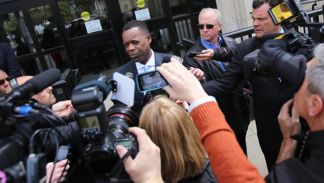 Detroit Emergency Financial Manager Kevyn Orr addresses the the media outside the Detroit Free Press and Detroit News on Monday, May 13, 2013,  in Detroit.