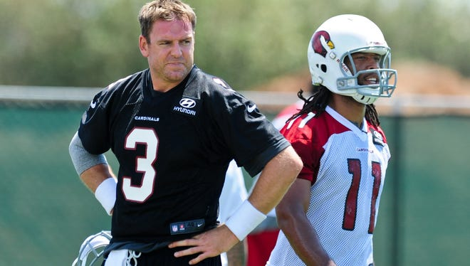 Arizona Cardinals quarterback Carson Palmer (3) and wide receiver Larry Fitzgerald (11) looks on during organized team activities at the Cardinals Training Facility.