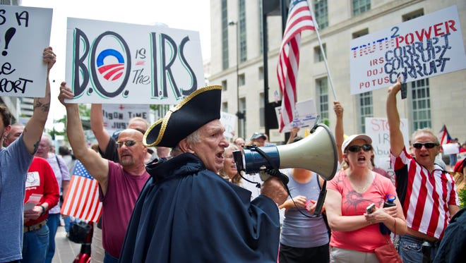 Tea party protester Paul Johnson, of Walton, Ky.,voices his displeasure with the IRS in during a protest in Cincinnati.