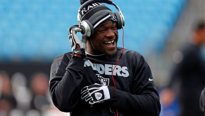 Running back Mike Goodson, shown here with the Raiders in 2012, faces gun and drug charges after a May arrest in N.J.