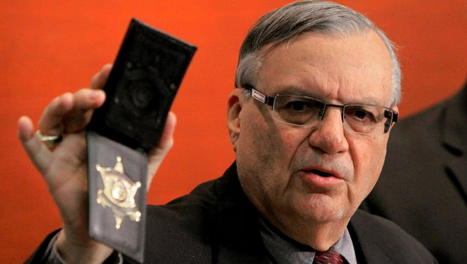 Maricopa County Sheriff Joe Arpaio shows his badge in 2011. One of his supporters managed to get a deputy's badge and now is charged with impersonating a deputy.