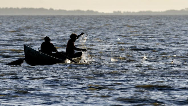 Two fishermen lift their net in Lake Managua, near Managua, Nicaragua. The Central American goverment is trying to revive a centuries-old dream of building an inter-ocean canal.