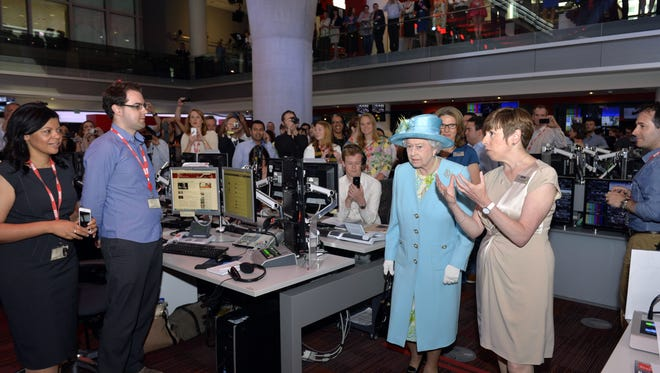 Queen Elizabeth II visits BBC to open its new headquarters in London.