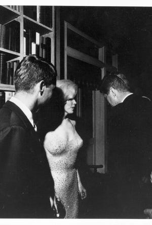 Robert Kennedy, left, and Marilyn Monroe talk with President Kennedy at the President's birthday party, May 29, 1962 in Madison Square Garden in New York.