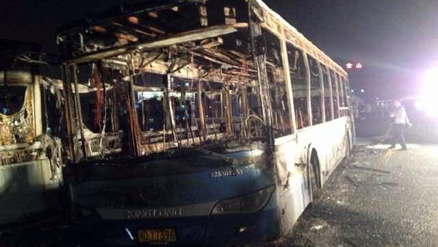 The remains of an express bus burst into flames in Xiamen, southeast China's Fujian Province on June 7, 2013.