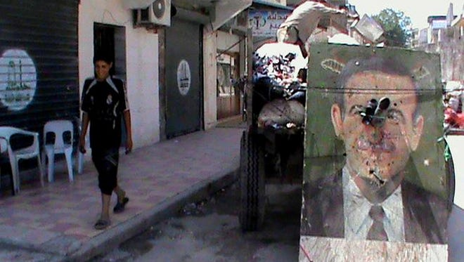 A poster of the late former Syrian President Hafez Assad in Aleppo, Syria.
