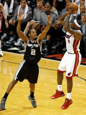 Heat forward LeBron James was forced into long shot attempts by Spurs defender Kawhi Leonard in Game 1 of the NBA Finals on Thursday.